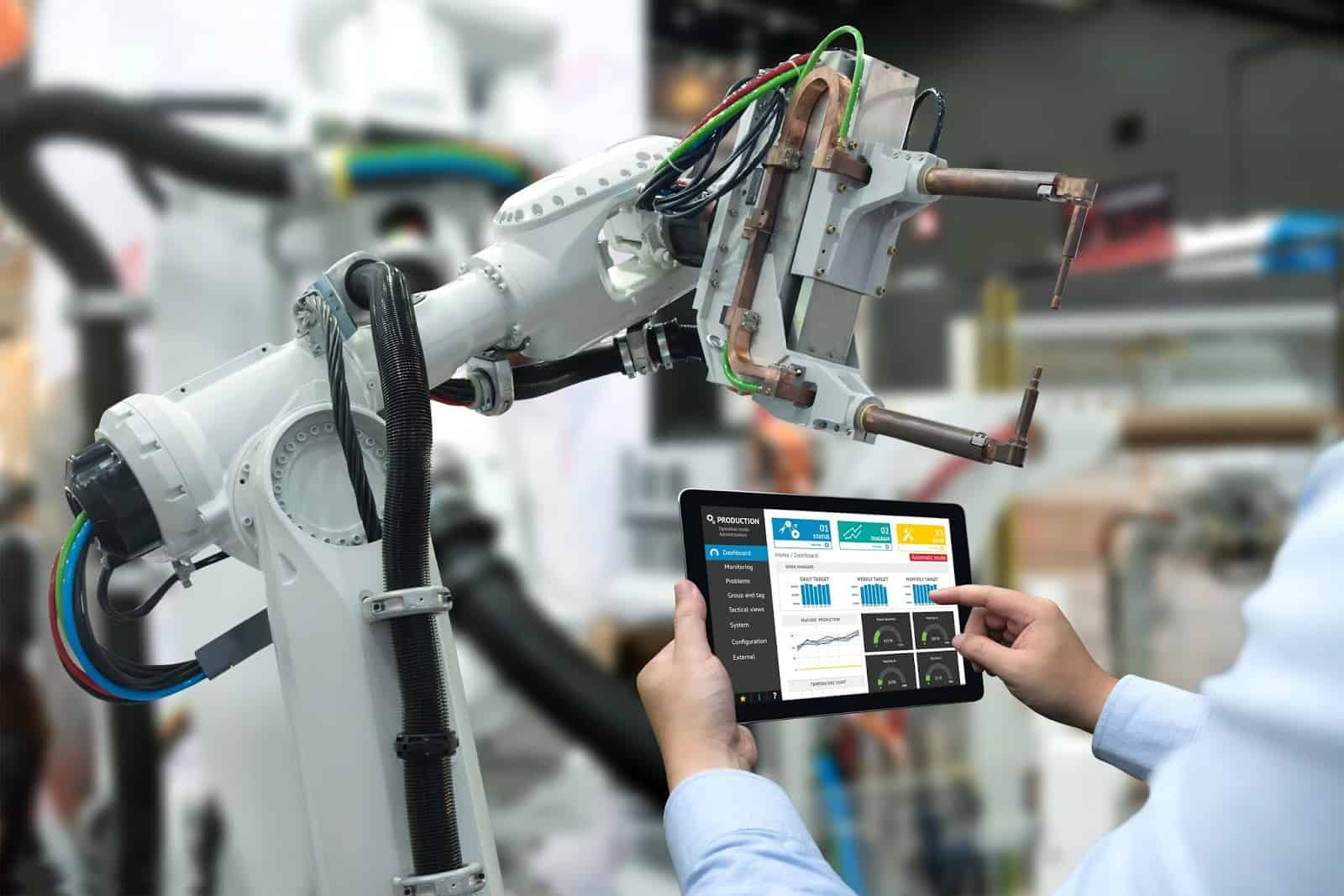 engineer using tablet with a robot